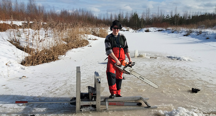 Otto-Ville Sormunen taking an ice sample at a treatment facility for peat bog water at Konnunsuo. Photo: Mikko Suominen, Aalto University